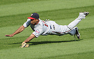 CHICAGO - JULY 09:  Ben Revere #11 of the Minnesota Twins makes a diving catch of a ball hit by Alex Rios #51 of the Chicago White Sox in the seventh inning on July 9, 2011 at U.S. Cellular Field in Chicago, Illinois.  The White Sox defeated the Twins 4-3.  (Photo by Ron Vesely)  Subject: Ben Revere;Alex Rios