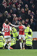 Theo Walcott of Arsenal FC (14) celebrates scoring his second goal to go 4-0 up goal during the The FA Cup fifth round match between Hull City and Arsenal at the KC Stadium, Kingston upon Hull, England on 8 March 2016. Photo by Ian Lyall.