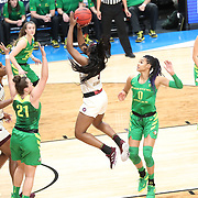March 31, 2019; Portland, OR, USA; Mississippi State Bulldogs forward Anriel Howard (5) shoots in between Oregon Ducks' defenders in the first half  of  the Elite Eight of the NCAA Women's Tournament at Moda Center.<br /> Photo by Jaime Valdez