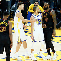OAKLAND, CA - MAY 31: Stephen Curry #30 of the Golden State Warriors talks to LeBron James #23 of the Cleveland Cavaliers next to Klay Thompson #11 of the Golden State Warriors and Tristan Thompson #13 of the Cleveland Cavaliers in Game One of the 2018 NBA Finals won 124-114 in OT by the Golden State Warriors over the Cleveland Cavaliers at the Oracle Arena on May 31, 2018 in Oakland, California. NOTE TO USER: User expressly acknowledges and agrees that, by downloading and or using this photograph, User is consenting to the terms and conditions of the Getty Images License Agreement. Mandatory Copyright Notice: Copyright 2018 NBAE (Photo by Chris Elise/NBAE via Getty Images)
