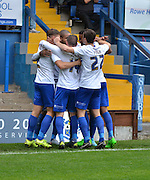 Bury Striker Leon Clarke is sureounded by his team mates after his spot kick goal during the Sky Bet League 1 match between Bury and Coventry City at Gigg Lane, Bury, England on 26 September 2015. Photo by Mark Pollitt.