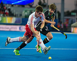 England's Henry Weir is watched by Florian Fuchs of Germany. England v Germany - Semi-Final Unibet EuroHockey Championships, Lee Valley Hockey & Tennis Centre, London, UK on 27 August 2015. Photo: Simon Parker
