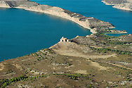 Aerial view of the Caspe Sea, an inland fresh water lake and damming area that looks like an ocean.