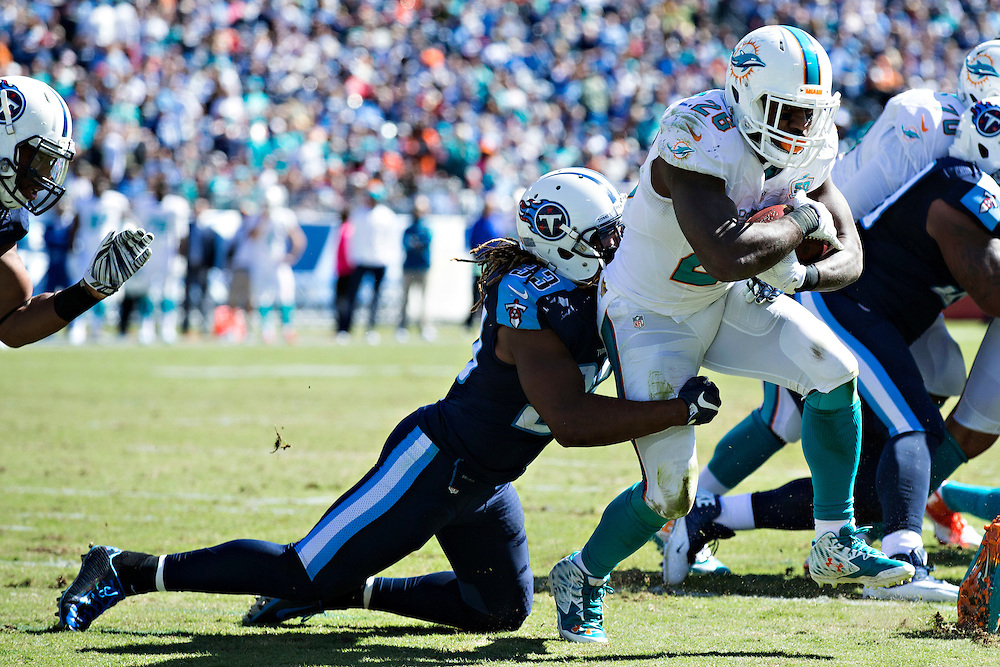 NASHVILLE, TN - OCTOBER 18:  Bobby McCain #28 of the Miami Dolphins runs the ball and is tackled by Michael Griffin #33 of the Tennessee Titans at LP Field on October 18, 2015 in Nashville, Tennessee.  The Dolphins defeated the Titans 38-10.  (Photo by Wesley Hitt/Getty Images) *** Local Caption *** Bobby McCain; Michael Griffin
