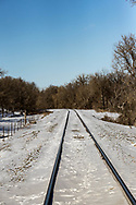 Railroad tracks fade off into the distance near the Missouri River north of Mandan, ND, on Monday, Feb. 5, 2018.
