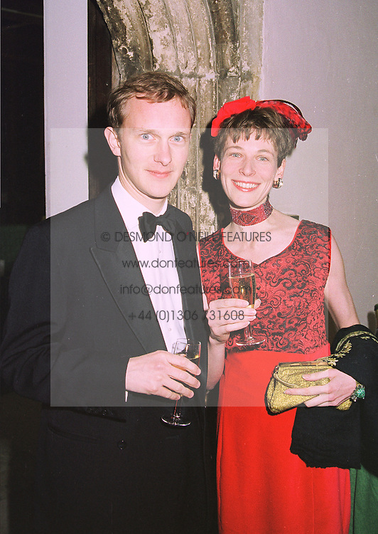 DR SIMON THURLEY and milliner KATHARINE GOODISON, at a dinner in London on 16th January 1998.MEP 9