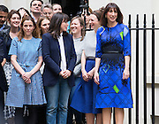 UNITED KINGDOM, London: 8 May 2015,  Samantha Cameron (R) stands with staff of Ten Downing Street as British Prime Minister David Cameron talks to media out side Downing Street after forming a new Conservative Government. London, England. Andrew Cowie / Story Picture Agency