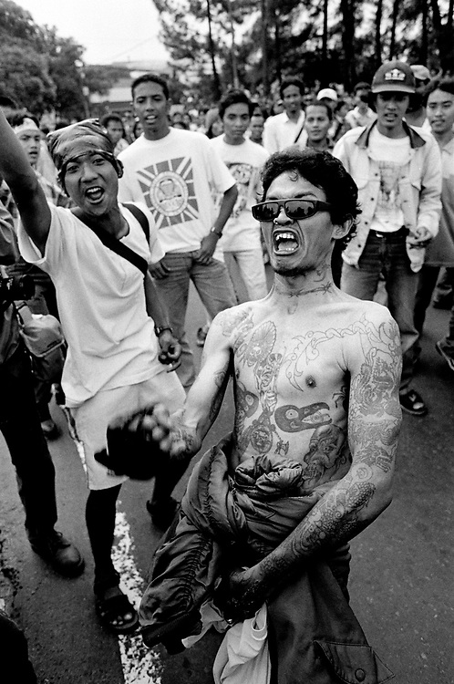 Students risk arrest as they demonstrate for Government Reform (Reformasi) outside the grounds of Gadja Mahda University. Yogyakarta Indonesia 1998