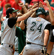 6/2/06 Lincoln, NE Manhattan University's Matt Rizzotti is mobbed by his teammates at home plate after hitting a home run in the 2nd inning against the University of Nebraska at Haymarket Park in Lincoln Ne Friday afternoon.  Manhattan one 4-1.(Chris Machian/Prairie Pixel Group)