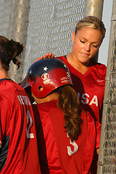 30 June 2004  USA's Jennie Finch gives a word of encouragement and a tap on the helmet to teammate  Lovieanne Jung. Bloomington Lady Hearts vs. USA Olympic Softball Team.  Champion Field #1.  Normal Illinois
