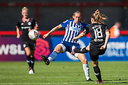 Maren Mjelde (Chelsea) puts a ball past Aileen Whelan (Brighton) during the FA Women's Super League match between Brighton and Hove Albion Women and Chelsea at The People's Pension Stadium, Crawley, England on 15 September 2019.