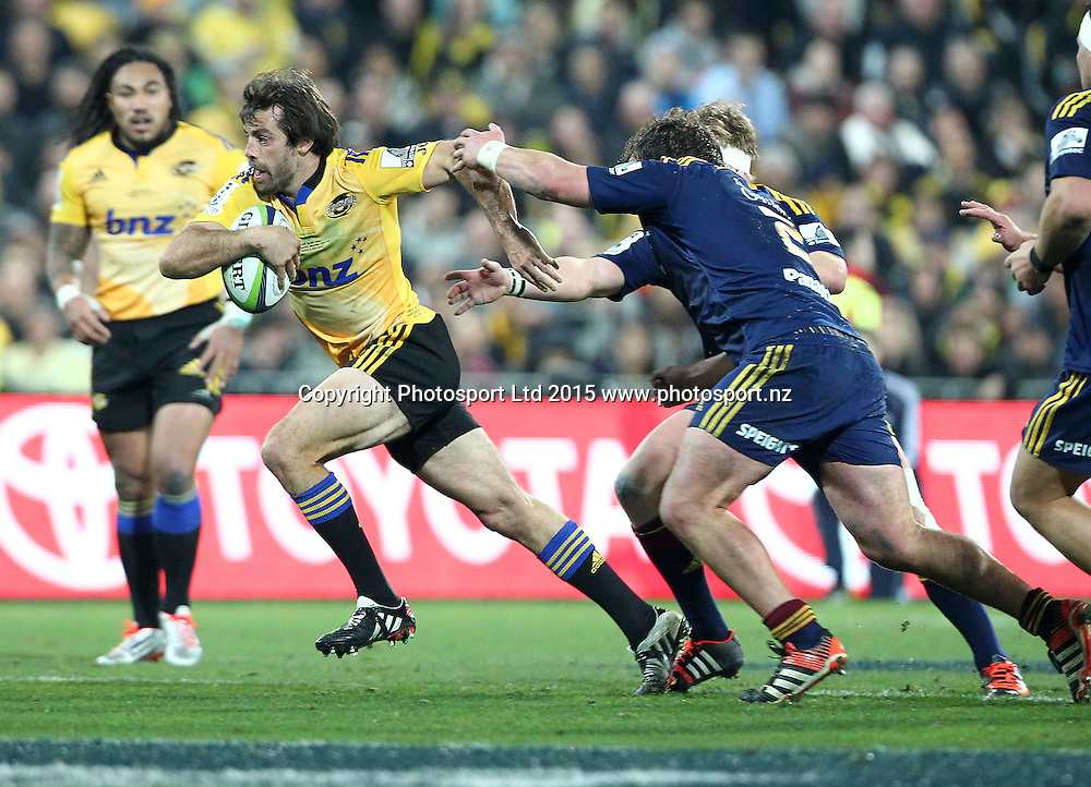 Hurricanes' Conrad Smith makes a break as Ma'a Nonu looks on during the Super Rugby Final, Hurricanes v Highlanders. Westpac Stadium, Wellington, New Zealand. 4 July 2015. Copyright Photo.: Grant Down / www.photosport.nz