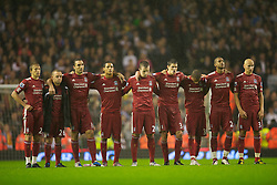 LIVERPOOL, ENGLAND - Wednesday, September 22, 2010: Liverpool's players stand and watch during the penalty shoot-out decider against Northampton Town during the Football League Cup 3rd Round match at Anfield. L-R: Lucas Leiva, Jay Spearing, Sotirios Kyrgiakos, Thomas Ince, Danny Wilson, Martin Kelly, Nathan Eccleston, David Ngog, Jonjo Shelvey. (Photo by David Rawcliffe/Propaganda)