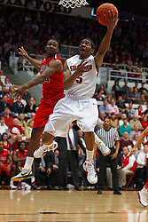Feb 4, 2012; Stanford CA, USA;  Stanford Cardinal guard Chasson Randle (5) shoots past Arizona Wildcats forward Solomon Hill (44) during the first half at Maples Pavilion.  Mandatory Credit: Jason O. Watson-US PRESSWIRE