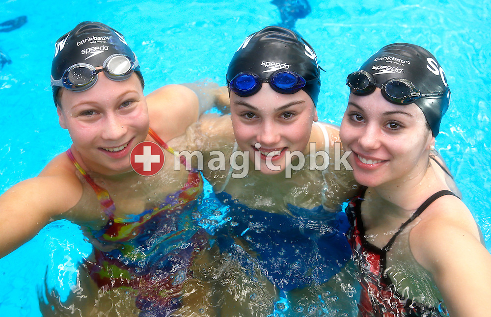 (L-R) SCUW's Julia FREI, Nadia EBERHART and Jessica EBERHART of Switzerland pose for a photo during the Swiss Swimming Championships at the Piscine des Vernets in Geneva, Switzerland, Friday, March 15, 2013. (Photo by Patrick B. Kraemer / MAGICPBK)