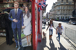 © Licensed to London News Pictures. 15/05/2018. Windsor, UK. Cardboard cutouts of Prince Harry and Meghan Markle are displayed in a shop selling royal wedding souvenirs ahead of their marriage on Saturday. Photo credit: Peter Macdiarmid/LNP