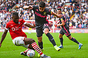 Leeds United midfielder Pablo Hernandez (19) and Barnsley defender Dimitri Cavare (12) during the EFL Sky Bet Championship match between Barnsley and Leeds United at Oakwell, Barnsley, England on 15 September 2019.