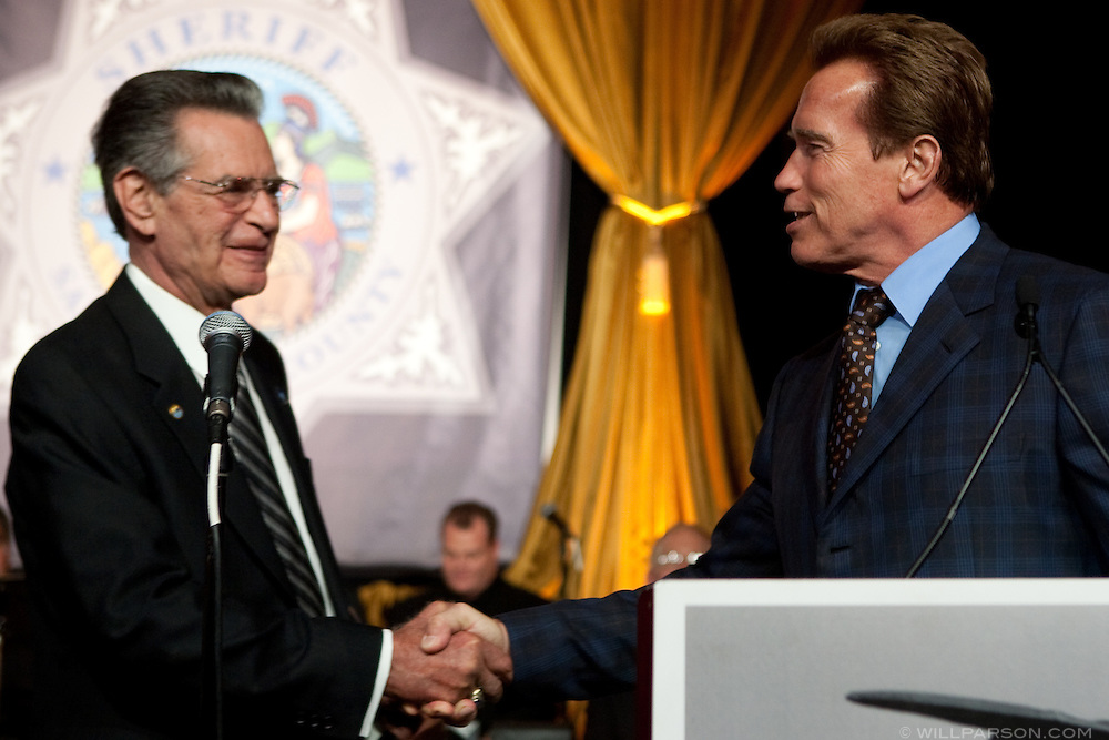 California Governor Arnold Schwarzenegger shakes hands with San Diego Sheriff Bill Kolender at his retirement party, Oct. 05, 2009.