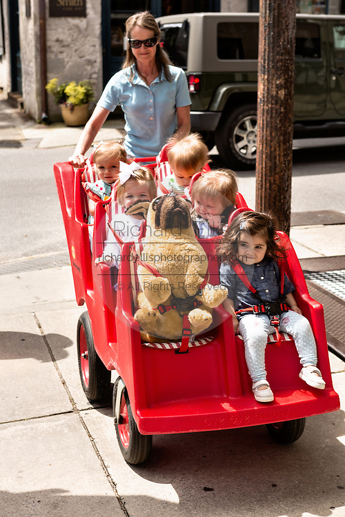 Nursery school children are pushed in a daycare stroller  in historic Charleston, SC.