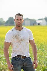 hot farmer in a dirty tee shirt on a farm