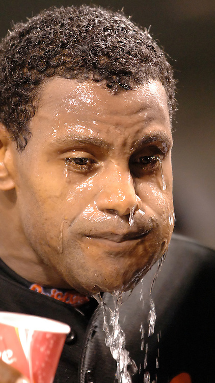 12 August 2005: The  Baltimore Orioles Sammy Sosa pours a cup of water on himself to cool off during the game against the Toronto Blue Jays in a game won by the Blue Jays 12-0 at Orioles Park at Camden Yards in Baltimore, MD.