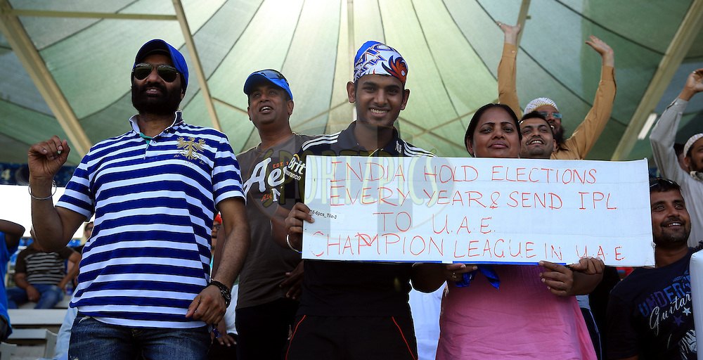 Fan's enjoys during match 16 of the Pepsi Indian Premier League 2014 between the Delhi Daredevils and the Mumbai Indians held at the Sharjah Cricket Stadium, Sharjah, United Arab Emirates on the 27th April 2014<br /> <br /> Photo by Sandeep Shetty / IPL / SPORTZPICS