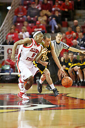 "18 January 2007: Matt Braeuer, dribbling, goes one on one on a fast break with Keith ""Boo"" Richardson. The Shockers of Wichita State were shut off by the Redbirds by a score of 83-75 at Redbird Arena in Normal Illinois on the campus of Illinois State University."