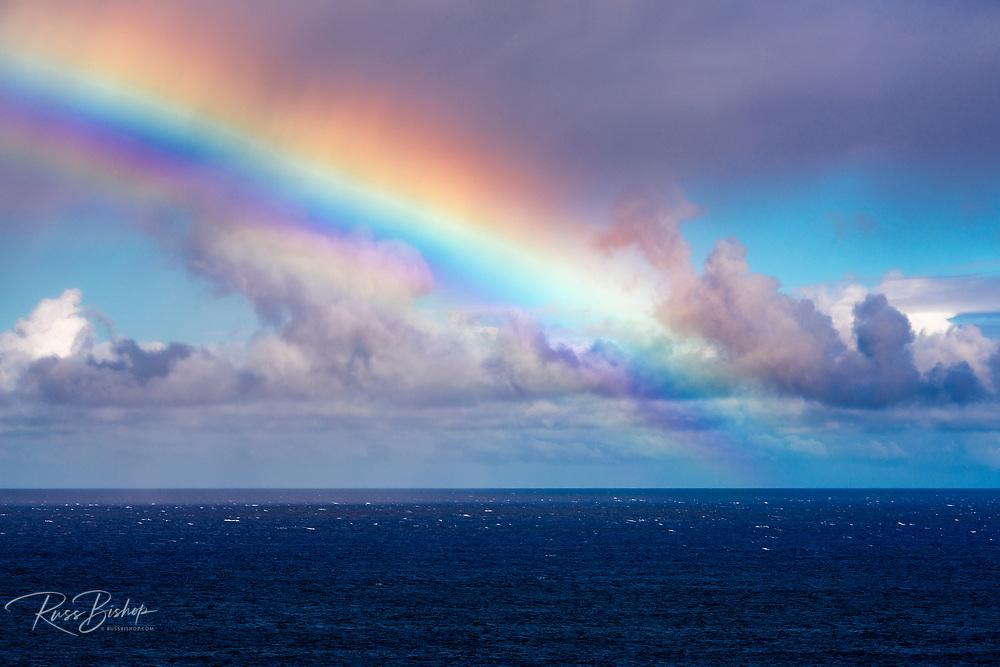 Rainbow and squall over the Pacific Ocean, Hanalei, Kauai, Hawaii USA