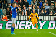 Kasper Schmeichel (#1) of Leicester City runs to congratulate Jamie Vardy (#9) of Leicester City after Leicester win the penalty shoot-out of the EFL Cup match between Newcastle United and Leicester City at St. James's Park, Newcastle, England on 28 August 2019.