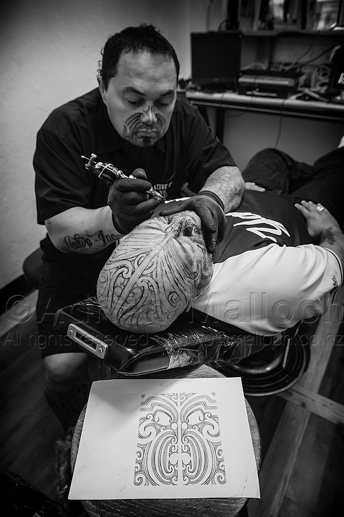 Roger Te Tai receives his ta moko; a traditional Māori face and head tattoo, at Native Inc in Whangarei.<br /> The ta moko is considered a taonga (treasure) to Māori for which the purpose and applications are sacred.<br /> Every moko contains ancestral/tribal messages specific to the wearer. These messages tell the story of the wearer's family and tribal affiliations, and their place in these social structures.<br /> A moko&rsquo;s message would also contain the wearer&rsquo;s understanding of their personal value, by way of their genealogy as well as the knowledge and responsibilities of their social position.