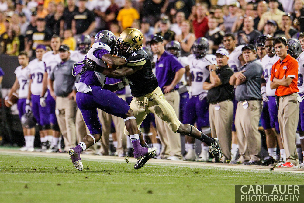 September 7th, 2013 - University of Central Arkansas Bears freshman wide receiver Jatavious Wilson (14) has the ball stripped by Colorado Buffaloes freshman defensive back Chidobe Awuzie (4) in the fourth quarter of action in the NCAA football game between the University of Central Arkansas Bears and the University of Colorado Buffaloes at Folsom Field in Boulder, CO