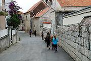 Walking the backstreets of Trogir, Croatia