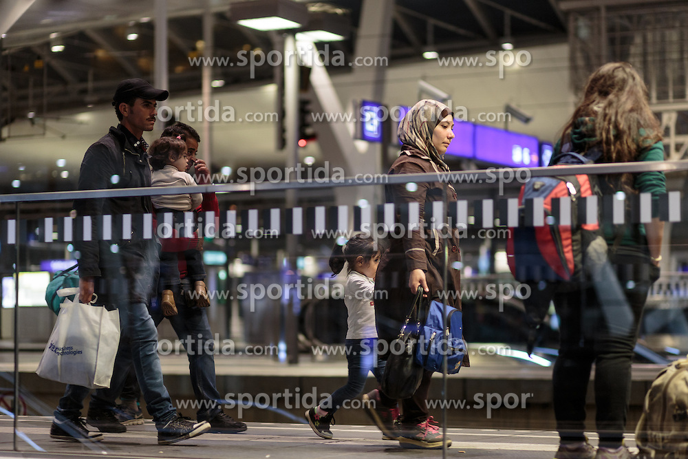 12.09.2015, Hauptbahnhof Salzburg, AUT, Fluechtlinge am Hauptbahnhof Salzburg auf ihrer Reise nach Deutschland, im Bild Flüchtlinge auf den Weg zum Zug nach Muenchen // Refugees on the way to the train to Munich. According to reports thousands of refugees fleeing violence and persecution in their own countries continue to make their way toward the EU, just days before Euopean leaders are set to meet in Brussels to discuss a solution to the arrival of so many people, Main Train Station, Salzburg, Austria on 2015/09/12. EXPA Pictures © 2015, PhotoCredit: EXPA/ JFK