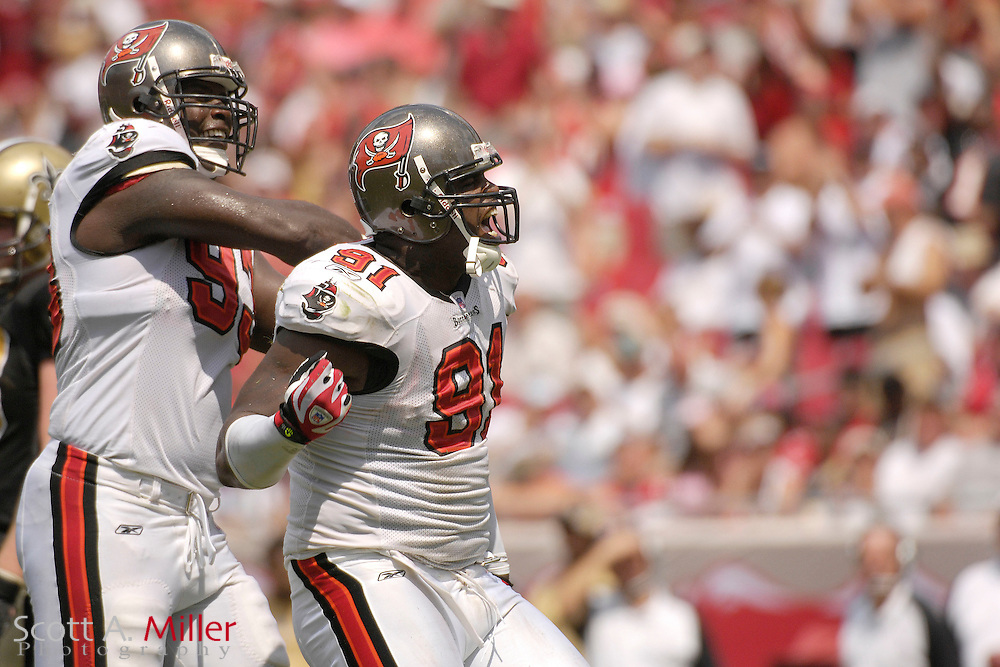 Sept. 16, 2007; Tampa, FL, USA; Tampa Bay Buccaneers defenders (91) Greg White and (93) Kevin Carter during their team's game against the New Orleans Saints at Raymond James Stadium. Tampa Bay won the game 31-14...©2007 Scott A. Miller