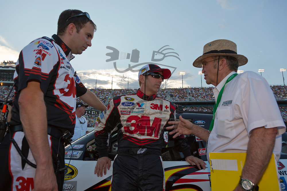 DAYTONA BEACH, FL - JUL 07, 2012:  Greg Biffle (16) talks with his car owner and crew chief before the start of the Coke Zero 400 at the Daytona International Speedway in Daytona Beach, FL.