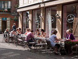 Small street cafe in summer on historic Haga Nygata street in Haga district of Gothenburg Sweden