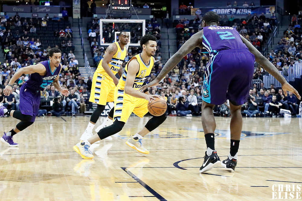 04 March 2017: Denver Nuggets guard Jamal Murray (27) drives past Charlotte Hornets forward Marvin Williams (2) during the Charlotte Hornets 112-102 victory over the Denver Nuggets, at the Pepsi Center, Denver, Colorado, USA.