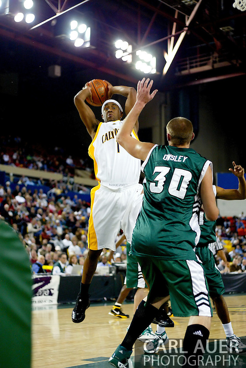 11/24/2006 - Anchorage, Alaska: Senior guard Ayinde Ubaka (1) of the California Golden Bears grabs a rebound as California secures a birth in the championship game of the 2006 Great Alaska Shootout destroying  Hawaii 72-56<br />