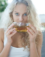 Portrait of young woman drinking herbal tea