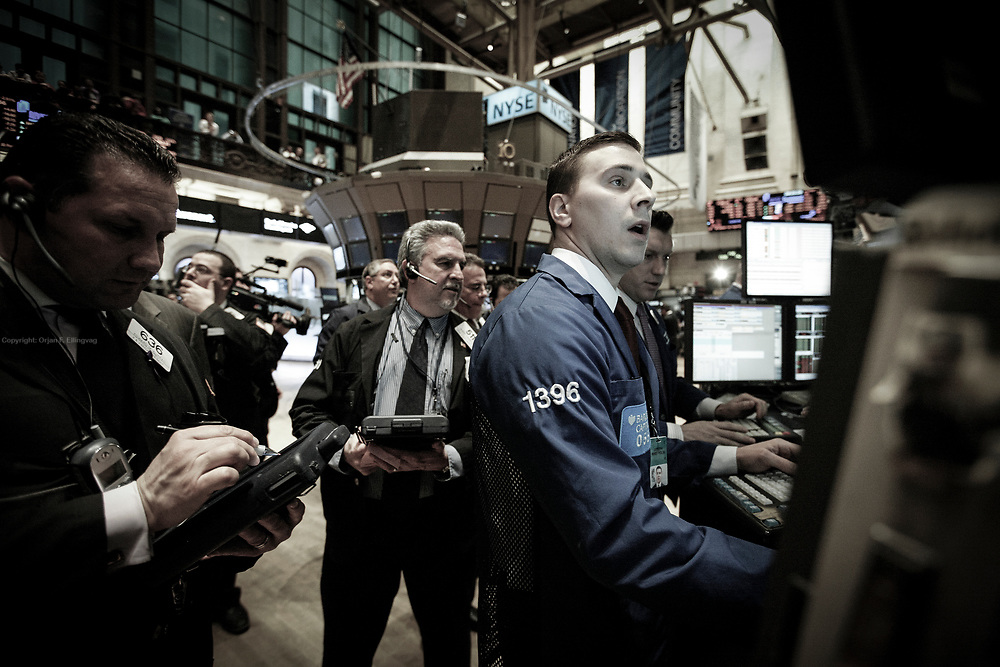 Floor specialists trade on the NYSE Euronext Stock Exchange. The NYSE New York Stock Exchange reacts nervously to the dire news from Japan.