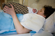 Ina, a drug user who is HIV-positive, holds her as-yet unnamed son for the first time at Botkin Hospital in St. Petersburg, Russia, on Wednesday, September 12, 2007.