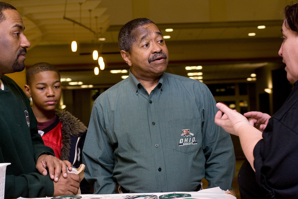 Dr. Kent Smith and his son Trey Smith, 14, along with President McDavis, speak with Catherine Murphy in the Marti and Stewie Craft area during Sibs Fest. The event, which featured a magician, games, karaoke, and etc., was organized by the UPC (University Program Council)