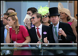 Image ©Licensed to i-Images Picture Agency. 21/06/2014. Ascot, United Kingdom.Princess Beatrice and Princess Eugenie (right, red)on the balcony of their box as they watch the racing on Day 5 of Royal Ascot. Ascot Racecourse. Picture by Andrew Parsons / i-Images