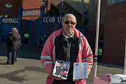 A program seller shows off the match program ahead of  the Ladbrokes Scottish Premiership match between Rangers and Celtic at Ibrox, Glasgow, Scotland on 12 May 2019.