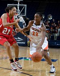 Virginia guard Monica Wright (22) dribbles past Davidson forward Mercedes Robinson (21).  The Virginia Cavaliers women's basketball team defeated the Davidson Wildcats 83-68 at the John Paul Jones Arena in Charlottesville, VA on December 20, 2007.