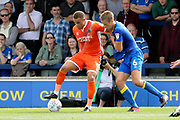 AFC Wimbledon defender Paul Robinson (6) battles for possession with Shrewsbury Town attacker Carlton Morris (9) during the EFL Sky Bet League 1 match between AFC Wimbledon and Shrewsbury Town at the Cherry Red Records Stadium, Kingston, England on 12 August 2017. Photo by Matthew Redman.