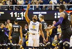 Jan 26, 2016; Morgantown, WV, USA; West Virginia Mountaineers guard Jaysean Paige (5) celebrates after scoring a three pointer during the first half against the Kansas State Wildcats at the WVU Coliseum. Mandatory Credit: Ben Queen-USA TODAY Sports
