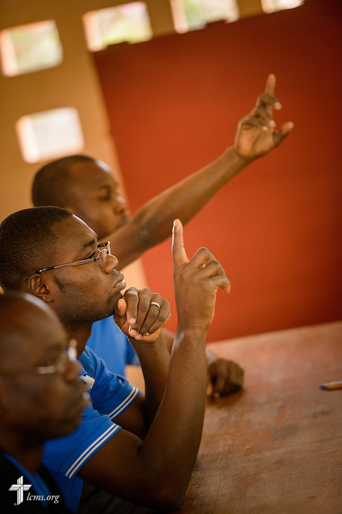 Students raise their hands before an exam at the Lutheran Center for Theological Studies (CLET) on Wednesday, Feb. 15, 2017, in Dapaong, Togo.  LCMS Communications/Erik M. Lunsford