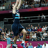 31 July 2012: Argentina Manu Ginobilo goes for the dunk during 71-64 Team France victory over Team Argentina, during the men's basketball preliminary, at the Basketball Arena, in London, Great Britain.
