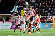 Northampton Town's Lawson D'Ath battles for the ball with Exeter City's Jamie McAllister during the Sky Bet League 2 match between Exeter City and Northampton Town at St James' Park, Exeter, England on 16 April 2016. Photo by Graham Hunt.